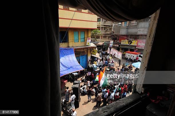 Kolkata Cricket fans watching World Cup SemiFinal between India and Australia on streets on March 26 2015 in Kolkata India