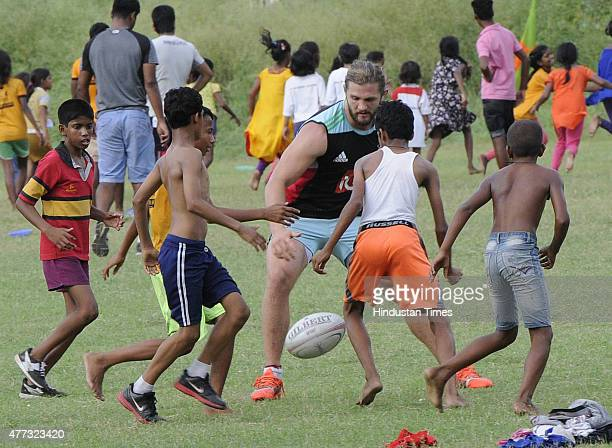 Kolkata, India 16, June, 2015 : World Class Rugby players of Harlequin FC playing with under privileged children of an NGO to promote the game. It is...