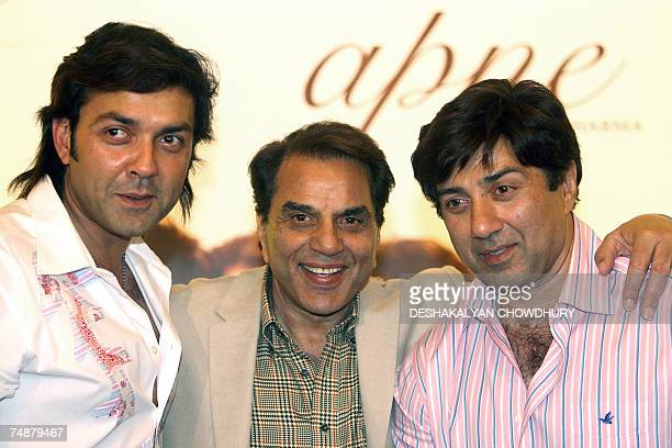 Indian actor and Member of Parliament Dharmendra poses for a photograph along with his two actor sons Bobby Deol and Sunny Deol during a promotional...
