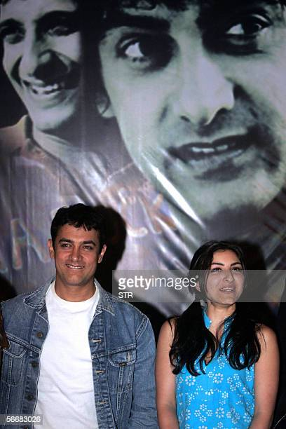Indian Bollywood actor Aamir Khan and costar Soha Ali Khan pose for a promotional event of their new movie Rang De Basanti in Kolkata 26 January 2006...