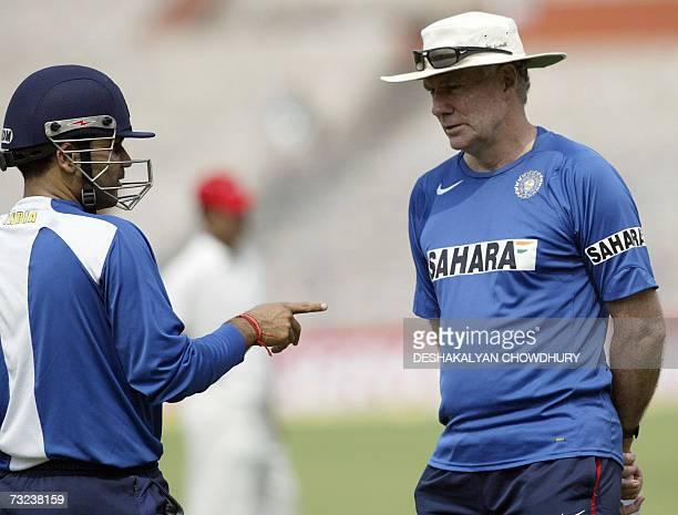 Indian cricket team coach Greg Chappell talks with player Virender Sehwag during a training session at the Eden Gardens Stadium in Kolkata 07...