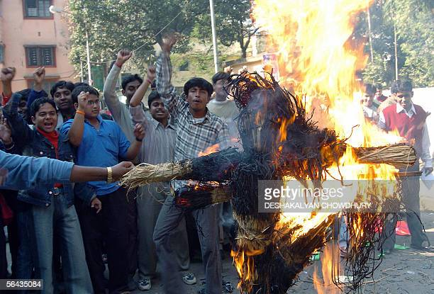 Indian students, supporters of former Indian cricket captain Sourav Ganguly shout slogans as they burn an effigy while taking part in a demonstration...