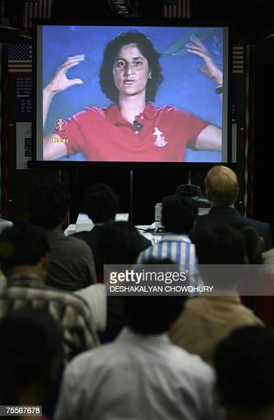 NASA Astronaut Commander Sunita Williams speaks to Indian students and journalists via a video conferencing link at The American Centre in Kolkata 20...