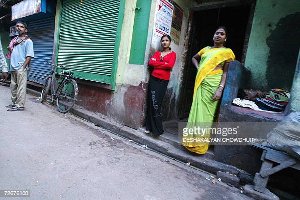 TO GO WITH 'HEALTHAIDSINDIAPHARMA' Indian sex workers wait for customers at Soanagachi Kolkata's largest redlight area 29 November 2006 India may be...