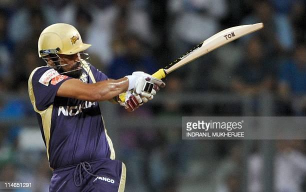 Kolkata Knight Riders batsman Yusuf Pathan plays a shot during the IPL Twenty20 match between Mumbai Indians and Kolkata Knight Riders at The...