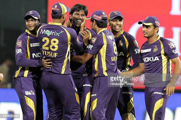 Kolkata Knight Riders bowler Laxmipati Balaji celebrates with teammates after taking wicket of Royal Challengers Bangalore batsman Virat Kohli during...