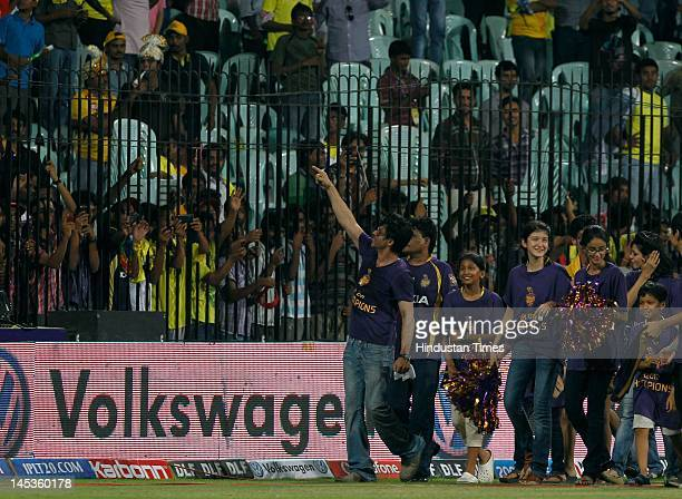 Kolkata Knight Riders coowner Shahrukh Khan with his daughter Suhana waves to fans in jubilation after his teams victory against Chennai Super Kings...