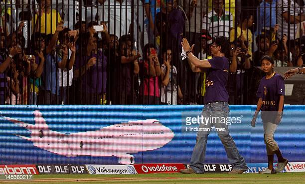 Kolkata Knight Riders coowner Shahrukh Khan with his daughter Suhana thanks the crowd for their support after his teams victory against Chennai Super...