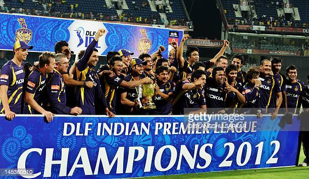 Kolkata Knight Riders cricketers support staffs and officials celebrate with the DLF IPL trophy after the IPL Twenty20 cricket final match between...