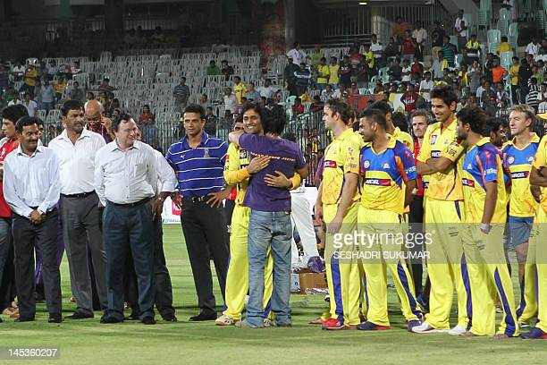 Kolkata Knight Riders owner and Bollywood actor Shah Rukh Khan gives Chennai Super Kings Captain a hug after the IPL Twenty20 cricket final match...