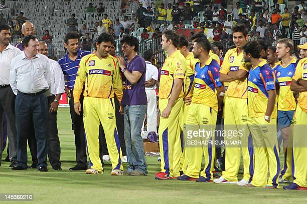 Kolkata Knight Riders owner and Bollywood actor Shah Rukh Khan talks to Chennai Super Kings Captain after the IPL Twenty20 cricket final match...