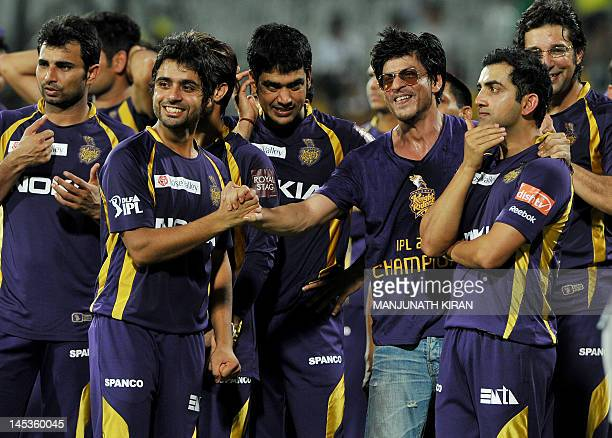 Kolkata Knight Riders owner and Bollywood actor Shah Rukh Khan celebrates with his teammates after they won the DLF IPL Twenty20 Champions Trophy in...