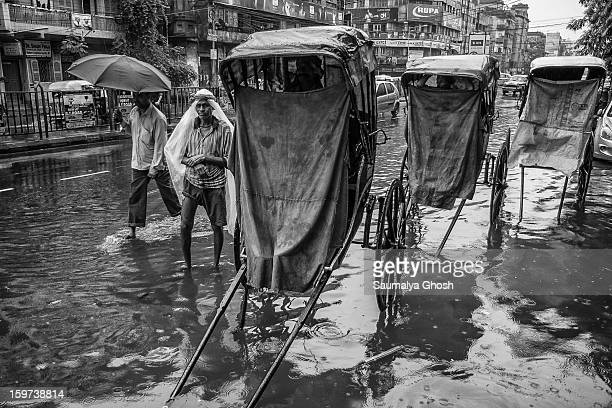 CONTENT] Kolkata streets are waterlogged after heavy monsoon Some busy roads are merely empty Hand pulled rickshaw drivers are waiting for business