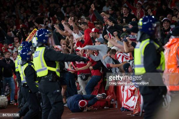 Koln fans celebrate their opening goal by spilling over the barriers during the UEFA Europa League group H match between Arsenal FC and 1 FC Koeln at...