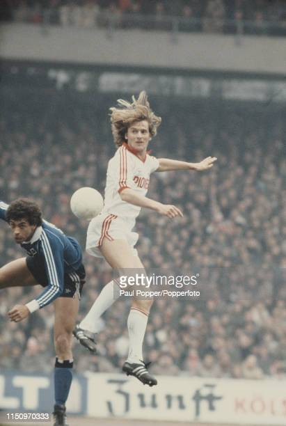 Koln midfielder Herbert Neumann pictured leaping for the ball during play between FC Koln and Hamburger SV in their 1979-80 Bundesliga match at...