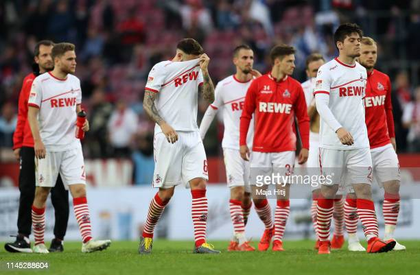 Koln players look dejected in defeat after the Second Bundesliga match between 1. FC Koeln and SV Darmstadt 98 at RheinEnergieStadion on April 26,...