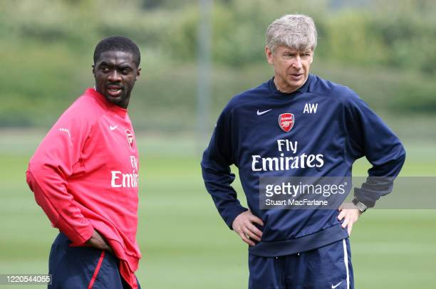 Kolo Toure and Arsene Wenger the Arsenal manager during an Arsenal training session on May 10, 2007 in St. Albans, England.
