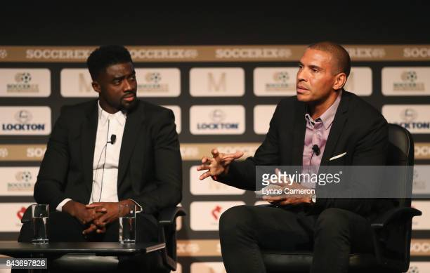 Kolo Toure and Stan Collymore talk during day 3 of the Soccerex Global Convention at Manchester Central Convention Complex on September 6 2017 in...