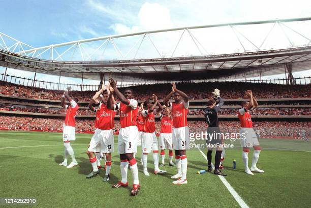 Kolo Toure and the Arsenal players clap the fans before the Premier League match between Arsenal and Aston Villa at Emirates Stadium on August 19...