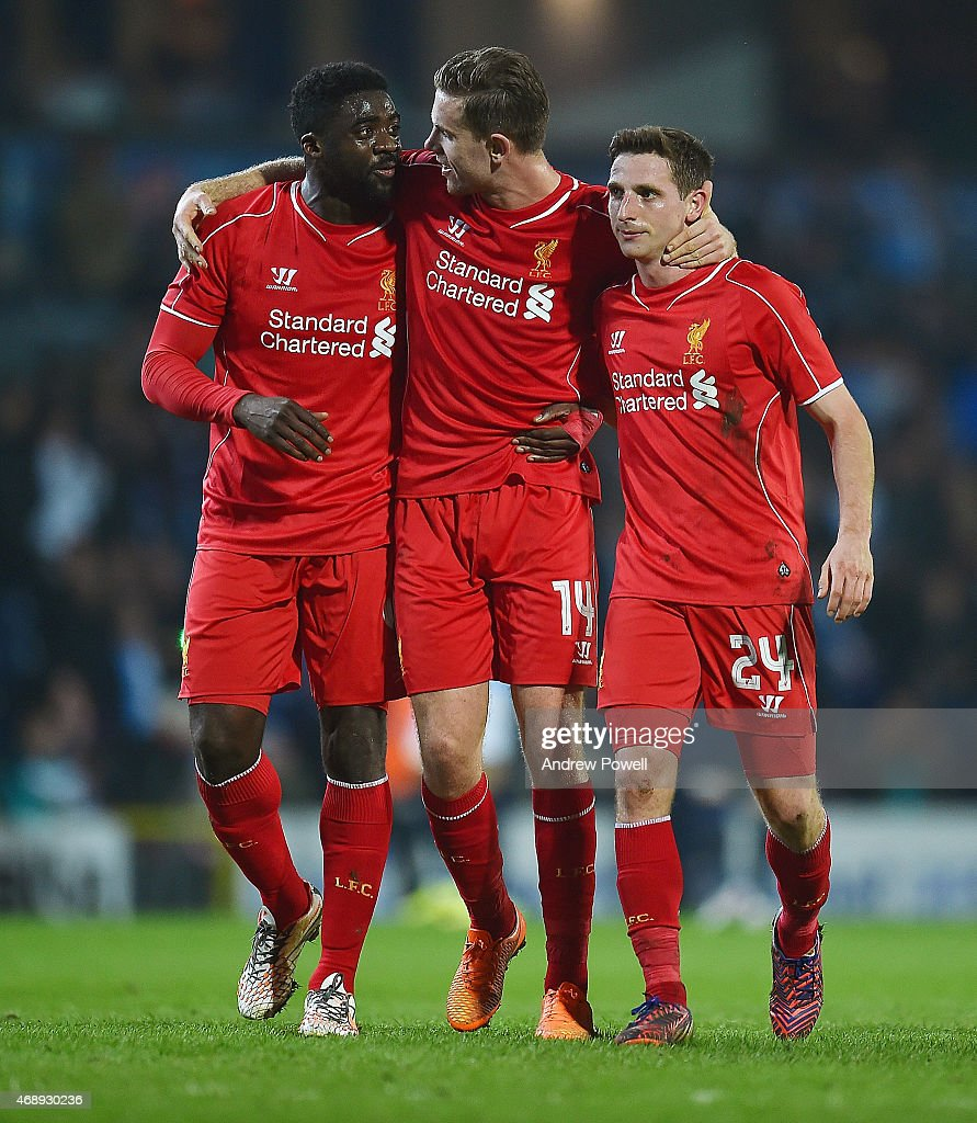 Kolo Toure, Jordan Henderson and Joe Allen of Liverpool celebrate at the end of the FA Cup Quarter Final Replay match between Blackburn Rovers and Liverpool at Ewood park on April 8, 2015 in Blackburn, England.