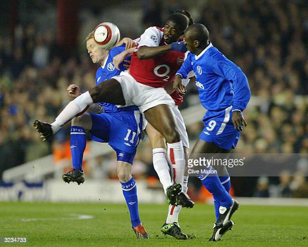 Kolo Toure of Arsenal battles for the ball with Damien Duff and Jimmy Floyd Hasselbaink of Chelsea during the UEFA Champions League Quarter Final...