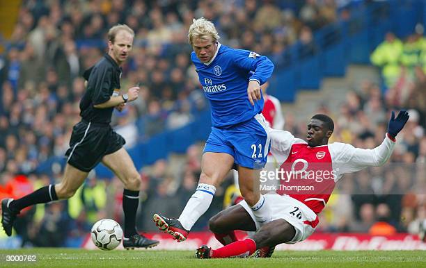 Kolo Toure of Arsenal battles for the ball with Eidur Gujohnsen of Chelsea during the FA Barclaycard Premiership match between Chelsea and Arsenal at...