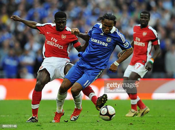 Kolo Toure of Arsenal challenges Didier Drogba of Chelsea during the FA Cup sponsored by EON Semi Final match between Arsenal and Chelsea at Wembley...