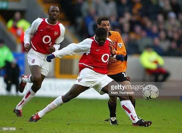 Kolo Toure of Arsenal tackles Vio Ganea of Wolves during the FA Barclaycard Premiership match between Wolverhampton Wanderers and Arsenal at Molineux...