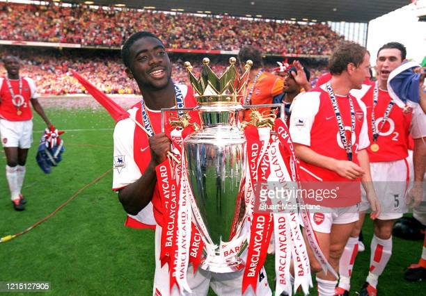 Kolo Toure of Arsenal with the Premier League trophy after the Premier League match between Arsenal and Leicester City on May 15, 2004 in London,...