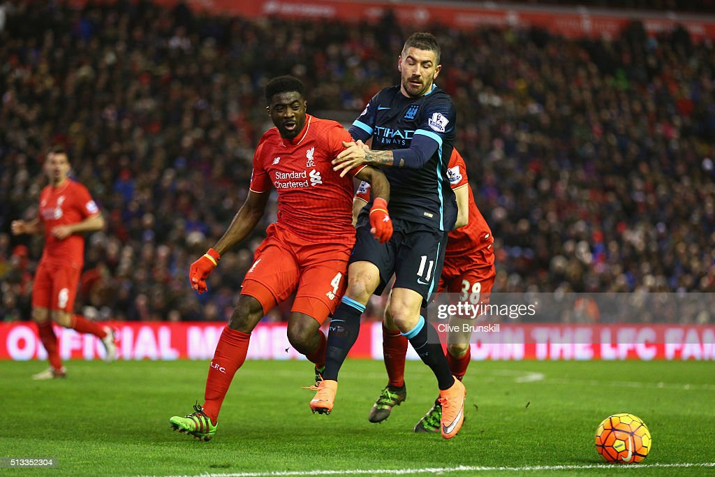 Kolo Toure of Liverpool and Aleksandar Kolarov of Manchester City battle for ball during the Barclays Premier League match between Liverpool and Manchester City at Anfield on March 2, 2016 in Liverpool, England.