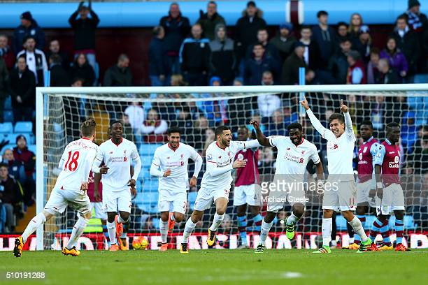 Kolo Toure of Liverpool celebrates with teammates after scoring his team's sixth goal during the Barclays Premier League match between Aston Villa...