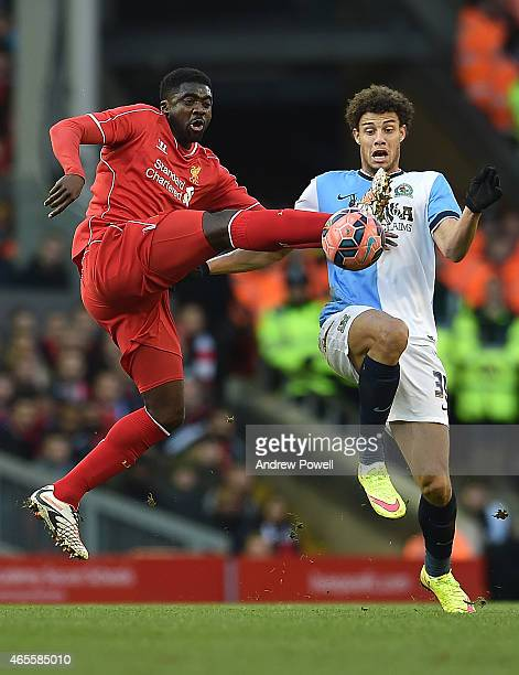 Kolo Toure of Liverpool competes with Rudy Gestede of Blackburn Rovers during the FA Cup Quarter Final match between Liverpool and Blackburn Rovers...