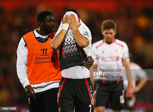 Kolo Toure of Liverpool consoles the dejected Luis Suarez of Liverpool following their team's 33 draw during the Barclays Premier League match...