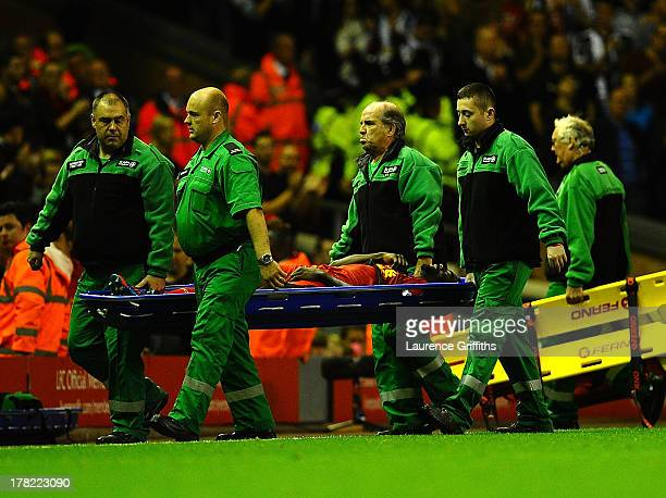 Kolo Toure of Liverpool is stretchered off during the Capital One Cup Second Round between Liverpool and Notts County at Anfield on August 27 2013 in...
