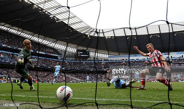 Kolo Toure of Manchester City is unable to stop Sebastian Larsson of Sunderland scoring his team's third goal during the Barclays Premier League...