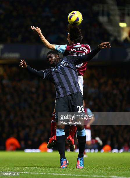 Kolo Toure of Manchester City jumps for a header with Yossi Benayoun of West Ham United during the Barclays Premier League match between West Ham...