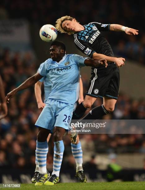 Kolo Toure of Manchester City jumps with Fernando Torres of Chelsea during the Barclays Premier League match between Manchester City and Chelsea at...