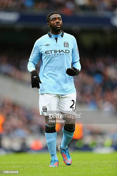 Kolo Toure of Manchester City loks on during the Barclays Premier League match between Manchester City and Manchester United at the Etihad Stadium on...