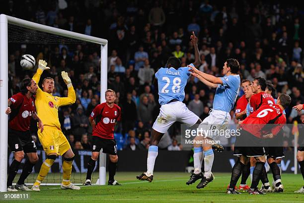 Kolo Toure of Manchester City scores to make it 21 in extra time during the Carling Cup third round match between Manchester City and Fulham at the...