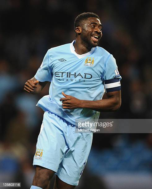 Kolo Toure of Manchester City smiles during the Carling Cup Third Round match between Manchester City and Birmingham City at the Etihad Stadium on...