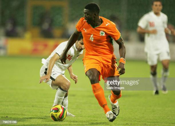Kolo Toure of the Ivory Coast and Said Moawad of Egypt in action during the AFCON semifinal match between Ivory Coast and Egypt held at the Baba Yara...