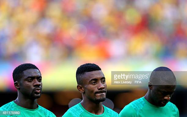 Kolo Toure Salomon Kalou and Yaya Toure of the Ivory Coast look on during the National Anthem prior to the 2014 FIFA World Cup Brazil Group C match...
