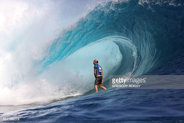 US Kolohe Andino rides a wave during the finale of the 14th edition of the Billabong Pro Tahiti surf event part of the ASP world tour on August 25...