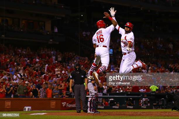 Kolten Wong and Jose Martinez of the St Louis Cardinals celebrate after Martinez's threerun home run against the Cleveland Indians in the second...