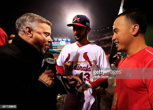 Kolten Wong and Matt Carpenter of the St Louis Cardinals are interviewed by FOX Sports News corespondent Jim Hayes after defeating the San Francisco...