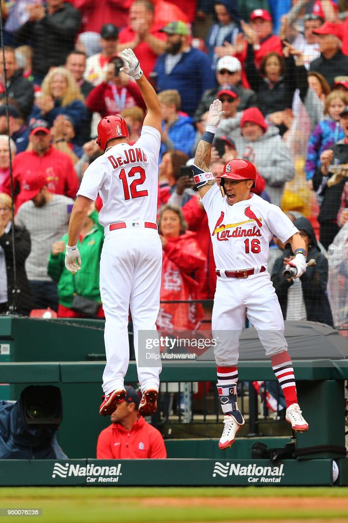 Kolten Wong #16 and Paul DeJong #12 of the St. Louis Cardinals celebrate after DeJung's three-run home run aCincinnati Reds in the seventh inning at Busch Stadium on April 22, 2018 in St. Louis, Missouri.