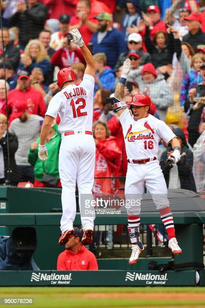 Kolten Wong and Paul DeJong of the St Louis Cardinals celebrate after DeJung's threerun home run aCincinnati Reds in the seventh inning at Busch...