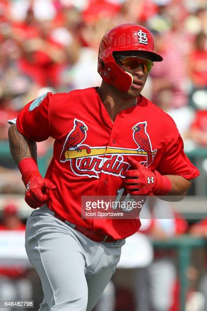 Kolten Wong of the Cardinals hustles down to first base during the spring training game between the St Louis Cardinals and the Atlanta Braves on...