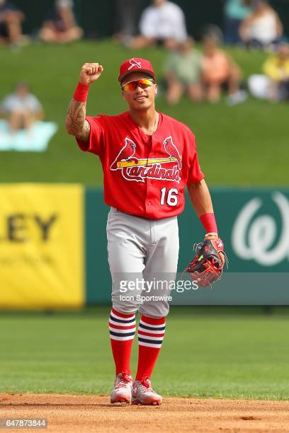 Kolten Wong of the Cardinals salutes a fan between innings during the spring training game between the St Louis Cardinals and the Atlanta Braves on...