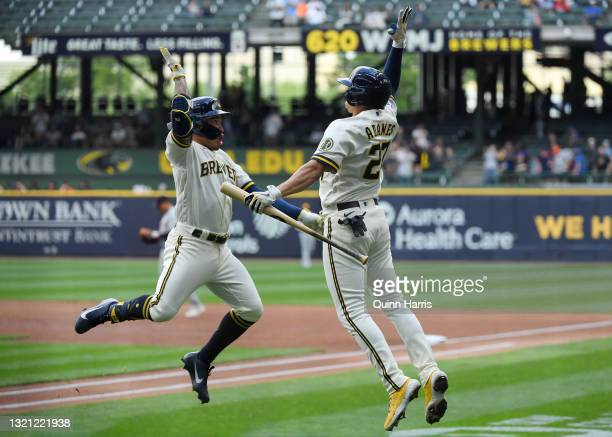 Kolten Wong of the Milwaukee Brewers celebrates with Willy Adames of the Milwaukee Brewers after his home run in the first inning against the Detroit...